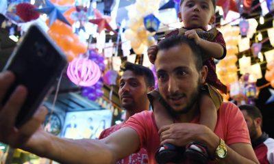 Hazájukba nyaralni járó szíriai menekültek